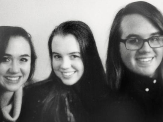 Siblings Alexandra Squire, from left, Victoria Squire,