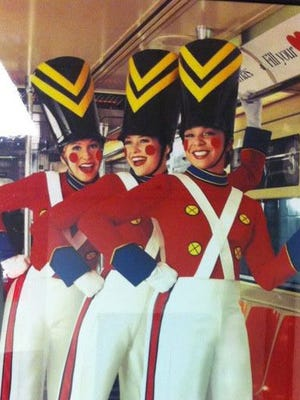 Amy Emmett (left) wearing the iconic Toy Soldier costume with fellow Radio City Rockettes in New York City.