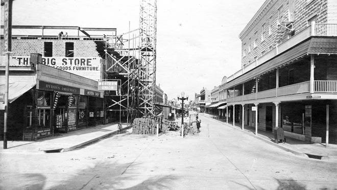 The corner of Clematis Street and Narcissus Avenue, looking west on Clematis circa 1916. The structure at left is the Palm Beach Mercantile Building, under construction.