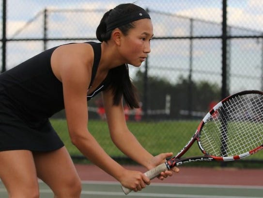 Bei Li Martin of Plymouth's 1 doubles team waits for