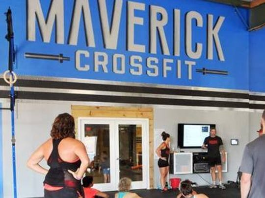 Athletes learn about the workout of the day at Maverick