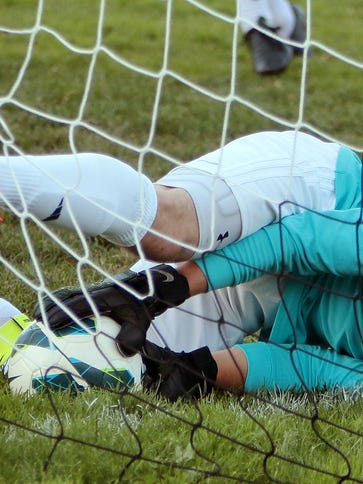 Cameron Gwinn, shown making a save in goal this month, scored three times for Hartland playing in the field on Monday.
