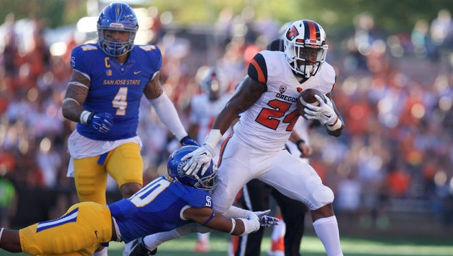 Sep 19, 2015; Corvallis, OR, USA; Oregon State Beavers running back Storm Woods (24) runs the ball as San Jose State Spartans safety Maurice McKnight (10) defends at Reser Stadium. Mandatory Credit: Scott Olmos-USA TODAY Sports