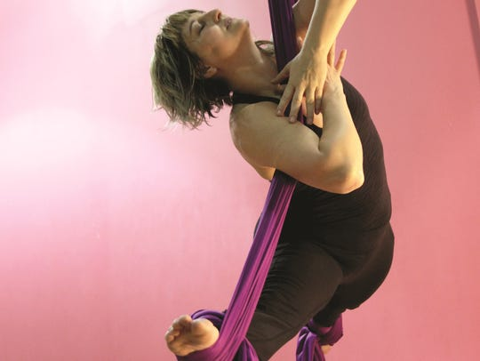 Holly Price works the aerial silks as part of the multi-layered