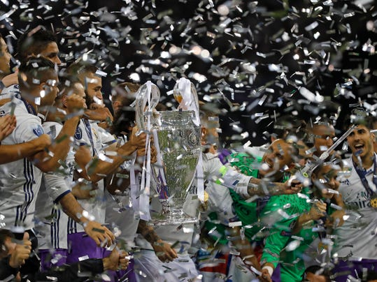 Real Madrid players celebrate at the end of the Champions League soccer final between Juventus and Real Madrid at the Millennium Stadium in Cardiff, Wales, Saturday, June 3, 2017. Real won the match 4-1. (AP Photo/Frank Augstein)
