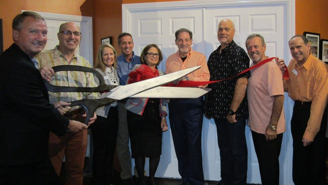 CVRep Board Chair Gary D. Hall and Founding Artistic Director Ron Celona share the honors of cutting the ribbon on the new Producers Club.  Also shown are (L-R): CVRep VP of Development Andrea Spirtos, CFRE; CVRep Board Member David Cohan; CVRep Development Director Barbara Wolser; from the City of Cathedral City, Councilmember Shelley Kaplan, Mayor Stan Henry, Councilmember Mark Carnevale; and CVRep Board Secretary Scott Sherman.