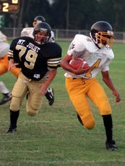 Central Middle's Taron Henry (4) plays against Mt. Juliet in 1996. Henry later wore No. 4 for Riverdale High and MTSU.