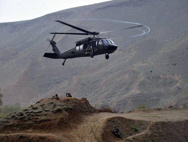A UH-60 Black Hawk helicopter prepares to land April 9, 2013, near the scene of a helicopter crash during a recovery operation in the Pachir Wa Agam district of Nangarhar province.