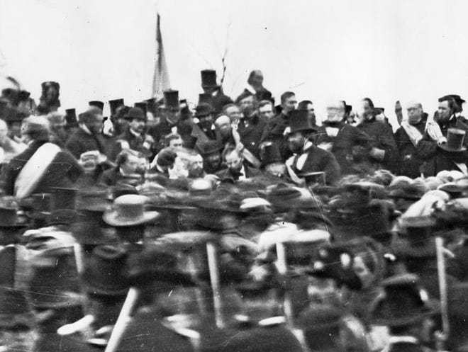 President Abraham Lincoln, center with no hat, speaks at the dedication of a national cemetery at Gettysburg, Pa., on Nov. 19, 1863.