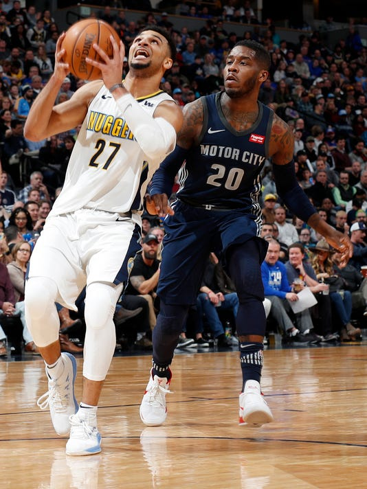 Denver Nuggets guard Jamal Murray, left, drives past Detroit Pistons guard Dwight Buycks on the way to the rim in the second half of an NBA basketball game Thursday, March 15, 2018, in Denver. The Nuggets won 120-113. (AP Photo/David Zalubowski)