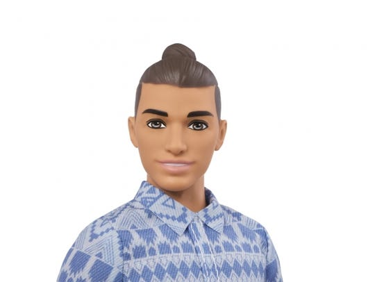 One of the new Kens boasts a man bun, almost as if