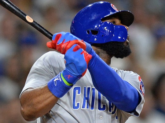 Will the Chicago Cubs continue to use slumping right fielder Jason Heyward (22), shown here vs. San Diego on Aug. 24, or one of his more productive teammates?
