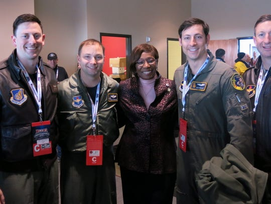 Independence Bowl flyover pilots pose with Shreveport Mayor Ollie Tyler, in pink.