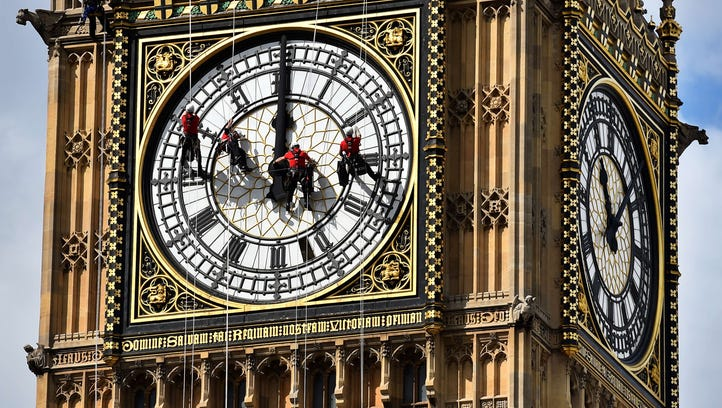 Technicians carry out cleaning and maintenance work on one of the faces of the Great Clock atop the landmark Elizabeth Tower that houses Big Ben, attached to the Houses of Parliament, in London, on August 19, 2014.