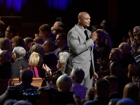 Show emcee Eddie George talks to the crowd during the 2017 American Football Coaches Awards at the Grand Ole Opry in Nashville, Tenn., Tuesday, Jan. 10, 2017.