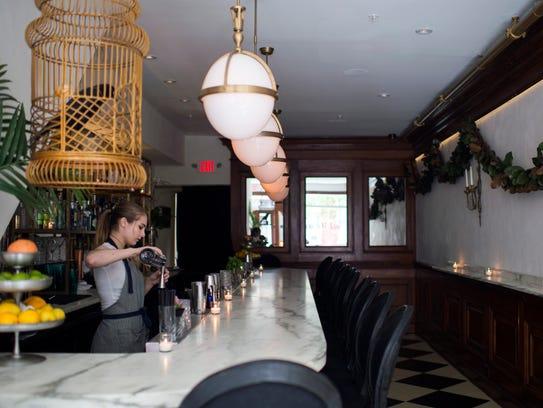 Bartender Madison Reynolds crafts a cocktail at Friday