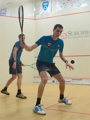 Egyptian Ali Farag concentrates on a return shot during