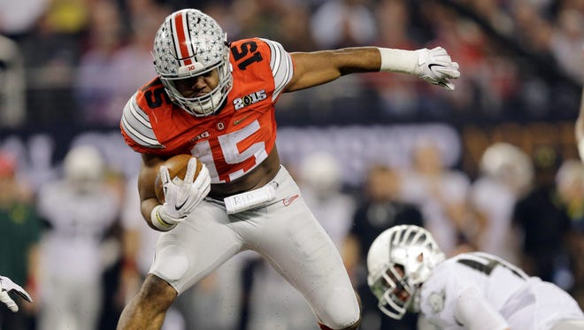 Ezekiel Elliott (15) is one of at least three potential legitimate Heisman trophy candidates on Ohio State's roster.