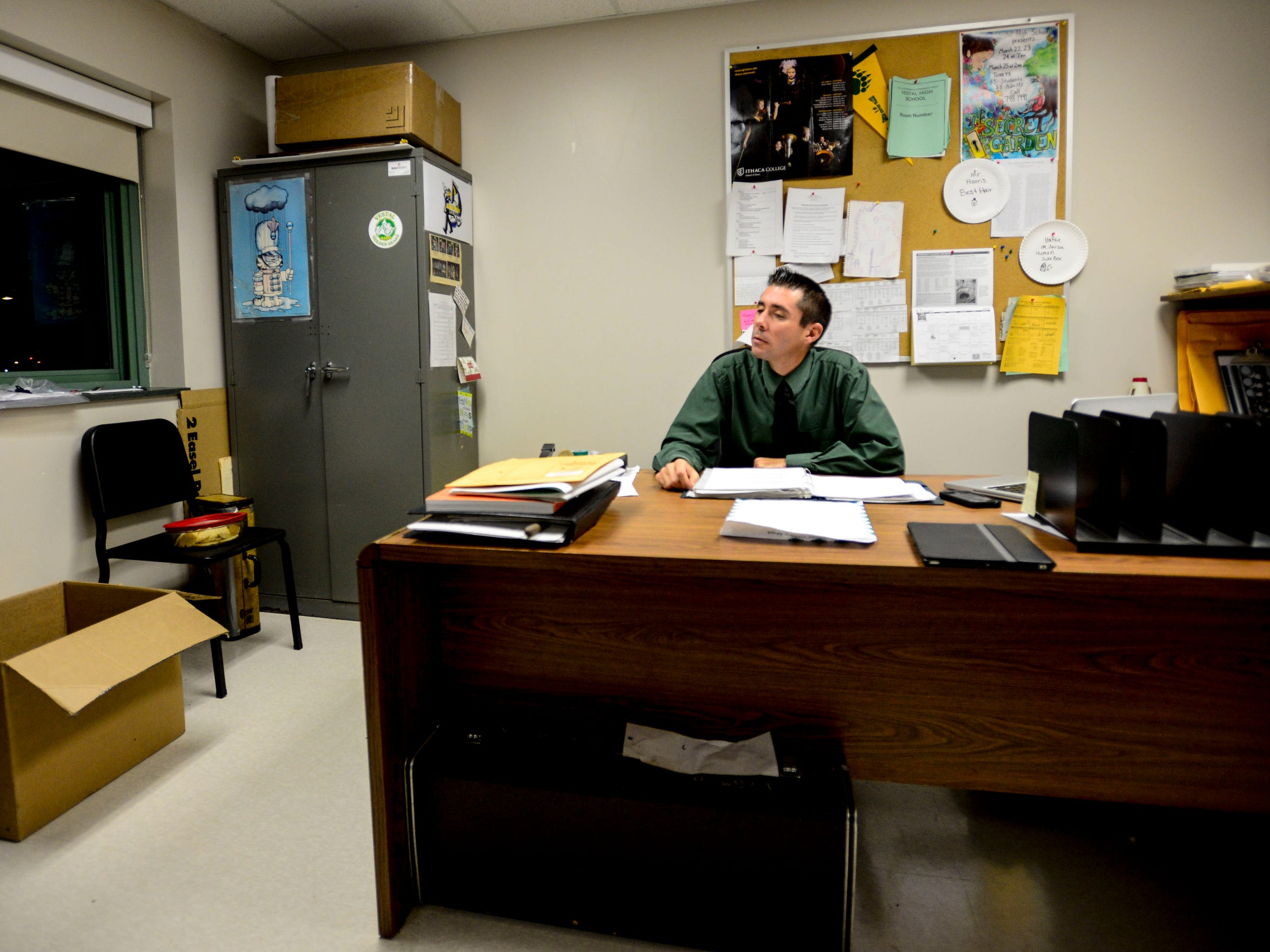 Vestal's band director Greg Harris gets into his office