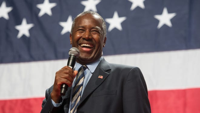 Presidential candidate Dr. Ben Carson smiles as he is cheered at a rally at the Anaheim Convention Center Arena in Anaheim, Calif., on Wednesday, Sept. 9, 2015.