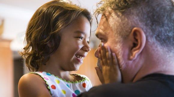 Amaya plays with her dad, Steve Ham, in their Peoria