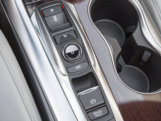 Among Bells And Whistles Cars Shift To Buttons Knobs