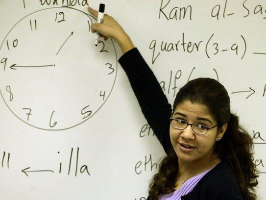 An ISU senior in 2002 teaches Arabic to seventh-and