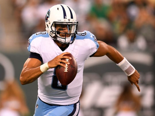 Titans quarterback Marcus Mariota (8) scrambles out of the pocket early in the first period of a preseason game at MetLife Stadium Saturday, Aug. 12, 2017 in East Rutherford, N.J..