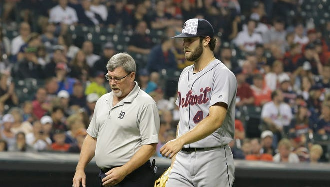 Tigers pitcher Daniel Norris, right, walks off the field with head athletic trainer Kevin Rand in the third inning of the Tigers' 5-3 loss Monday in Cleveland.