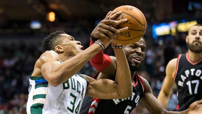 Raptors forward DeMarre Carroll defends Bucks forward Giannis Antetokounmpo during the third quarter in Game 4.