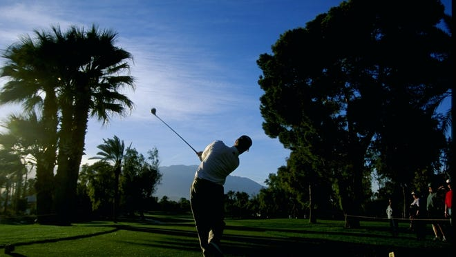 David Duval tees off during the 1999 Bob Hope Chrysler Classic at the Tamarisk Country Club in Rancho Mirage, California.