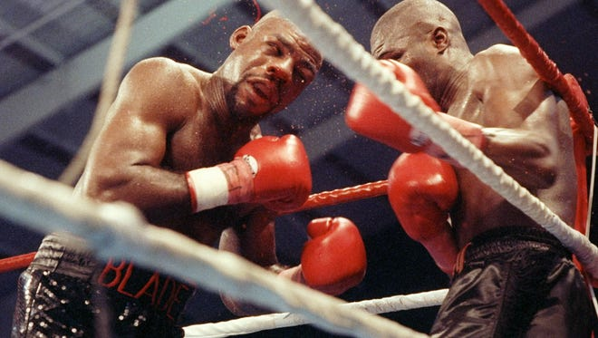 FILE PHOTO - 13 Feb 1993: James Toney and Iran Barkley in action during a bout in Las Vegas, Nevada.