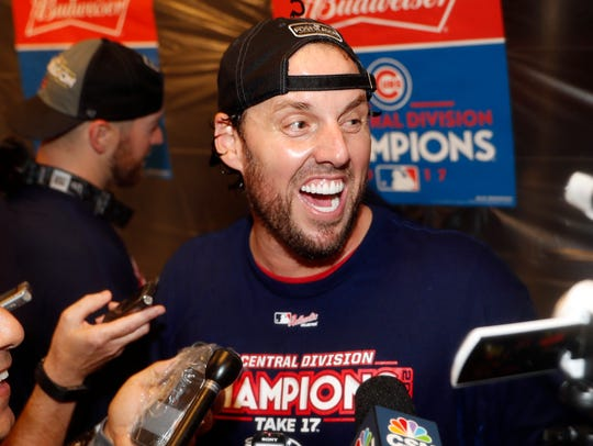 John Lackey celebrates after clinching the NL Central