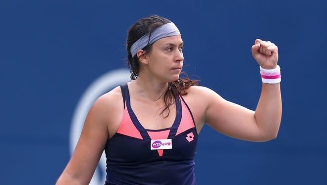 Marion Bartoli of France celebrates her 6-3, 6-0 victory aainst Lauren Davis of the USA.