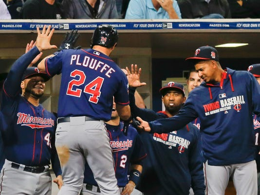 Minnesota Twins' Trevor Plouffe is greeted at the dugout after his home run against the San Diego Padres during the eighth inning of a baseball game Wednesday, May 21, 2014, in San Diego. (AP Photo/Lenny Ignelzi)