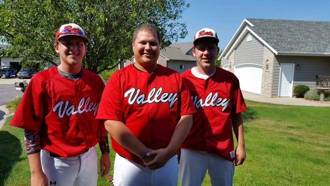 Jacob Mulder (from left), Josh Mulder and Jared Mulder play amateur baseball together.