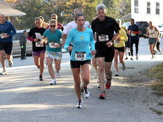 Cathy Butler leads the pack up Farquhar Park hill during a past White Rose run.