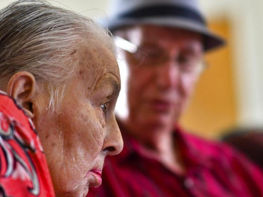 In this Tuesday, Aug. 21, 2018 photo, Jackie West, 86, of Eaton Rapids, listens as her husband Don, 90, sings to her during their anniversary party at the adult foster care home in Charlotte, Mich.