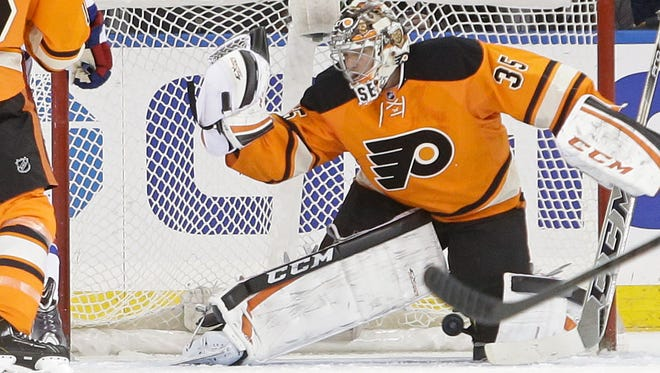 A puck shot by New York Rangers' Kevin Klein gets past Philadelphia Flyers goalie Steve Mason for a goal during the first period of an NHL hockey game Wednesday, Nov. 19, 2014, in New York.
