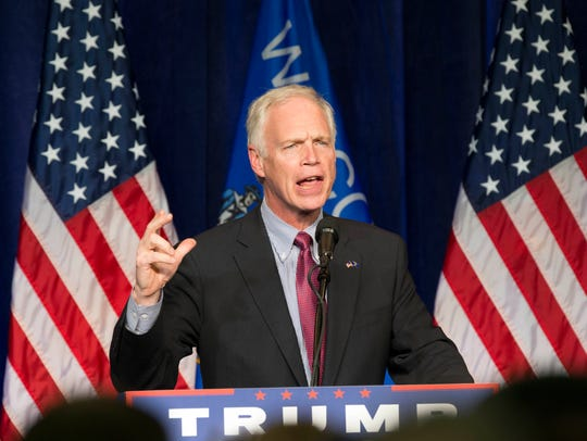Sen. Ron Johnson, R-Wis., addresses a rally for Donald