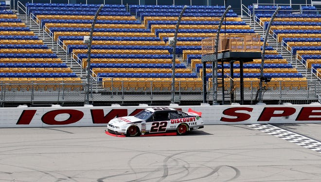 2012 Sprint Cup champion Brad Keselowski takes a lap on the track during NASCAR Nationwide Series test session was held Tuesday, May 6th, 2014, at Iowa Speedway.