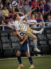 Louisville City FC midfielder Magnus Rasmussen (7) collides a Nashville SC player on Wednesday.