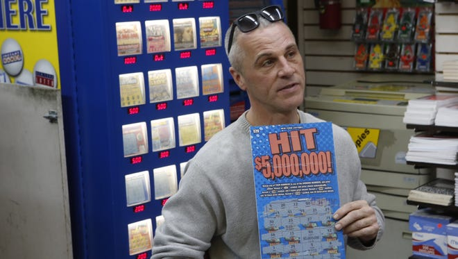 """Kevin Buchanan of Yonkers, N.Y., was named as the top prize winner in the lottery's """"Hit $5,000,000"""" scratch-off game Wednesday , Jan. 28, 2015."""