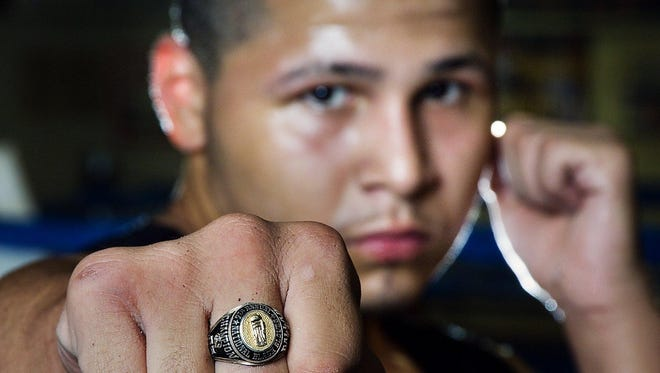 Antonio Bailey displays his Black Gloves national championship ring at Crown Boxing Club in Lansing in 2005.