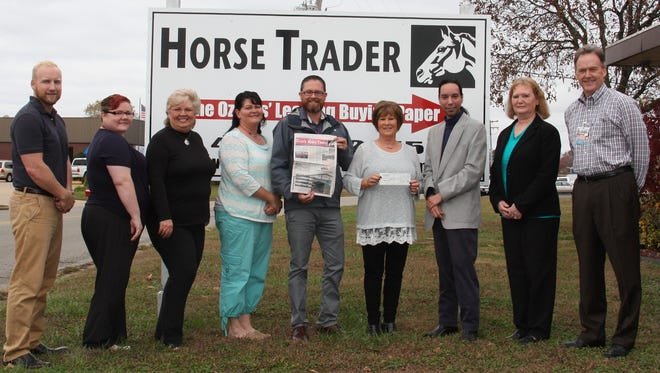 From left: Josh Henry, Melissa Talbi, Kathy Pierce, Kim Owsley, Brad Trail, Deb Cotter, David Ramey, and Patty Hocking, all with the Ozark Horse Trader, and Ward Franz, Executive Director of the OMC Foundation.