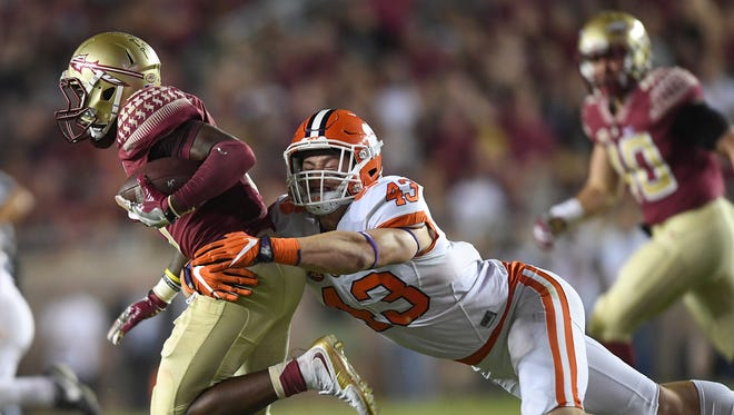 Clemson linebacker Chad Smith (43) brings down Florida State wide receiver Kermit Whitfield (8) during a kickoff return in the fourth quarter at Florida State's Doak Campbell Stadium in Tallahassee, Florida, on Saturday.