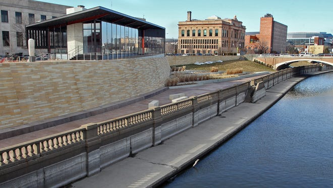 The Hub Spot, left, on the Principal Riverwalk on the west side of the Des Moines River near Court Ave.