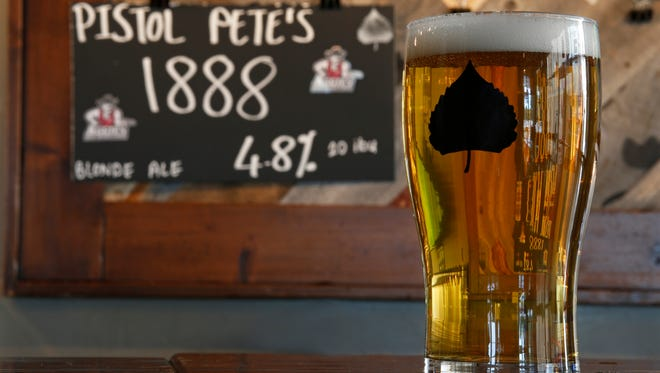 A glass of the new Pistol Pete's 1888 Ale is shown at the Las Cruces taproom of Bosque Brewing Co. The ale will be available at all NMSU football and men's basketball home games, while cans will be available statewide in early 2018.