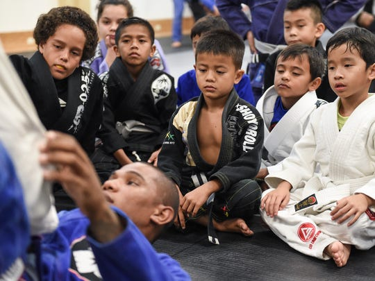 Isaac Balajadia instructs a group of young students at the Figo'/Bonsai Academy Guam in the International Sports Center in Anigua on Oct. 13