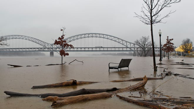 Rising water from the Ohio River was creeping higher on East Water Street in New Albany Tuesday afternoon. This is the highest the Ohio River has been since 2011. By Matt Stone, The Courier-Journal March 10, 2015